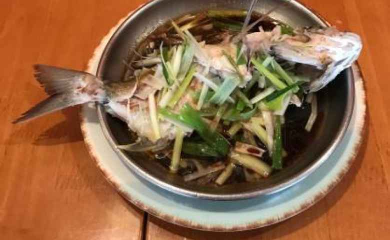 Fish cooked a traditional way is always a hit at the China Flute